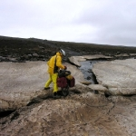 Crossing a crevasse in central Iceland