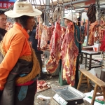 Tibetan monk choosing meat