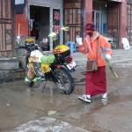 Monk washing motorcycle