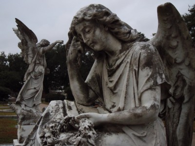 Monuments in Cemetery in Mobile, Alabama: Silent Vigil of Moss