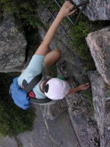 Claire Rogers climbing the Precipice Trail in Acadia National Park