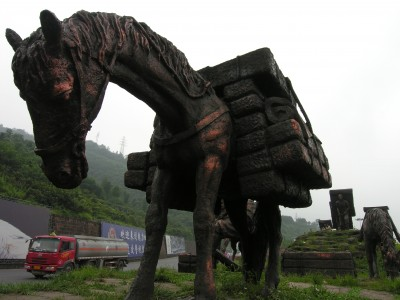 Horse, Symbol of Ancient Tea Horse Route, and Tanker Truck, Symbol of the Modern Route