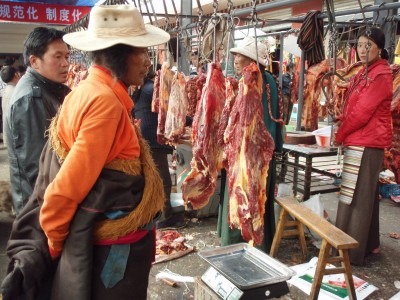 Monk at the Litang Meat Market