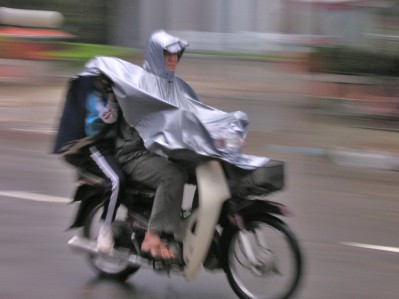Mom delivering child to school, Hue style