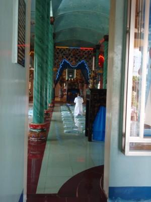 Man Praying in a Temple