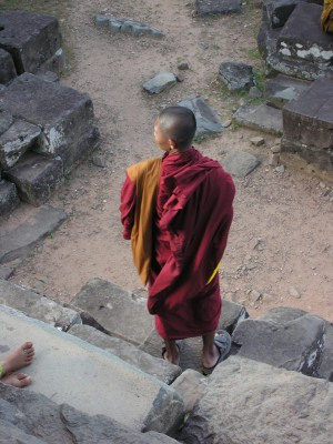 Buddhist Monk and Ruins near Angkor Wat