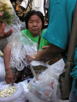 woman at wholesale market beside the Chao Praya in Bangkok