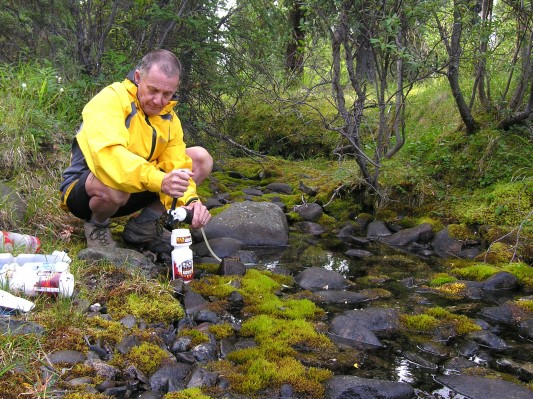Bob Rogers filtering water in Denali national Park