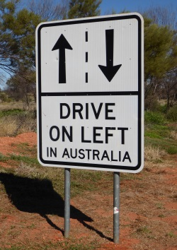 So many foreign visitors near Uluru that they have to be reminded