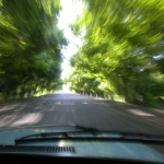 Young Azerbejan men drive rickety Ladas fast.