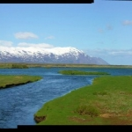 Panorama of and Icelandic river entering the sea.