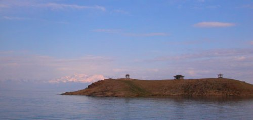 Island temple in the shadow of Tian Shan.