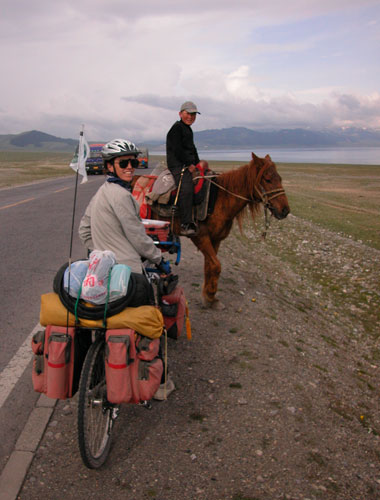 Uyghur boy and his fast pony.