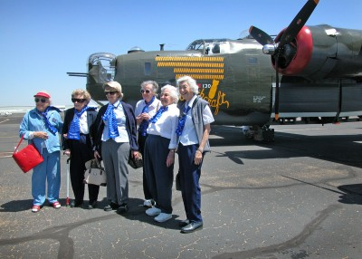 WASPs gather beside a B-24 prior to a flight of memory.
