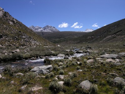 Stream and mountain on Tibetan plateau