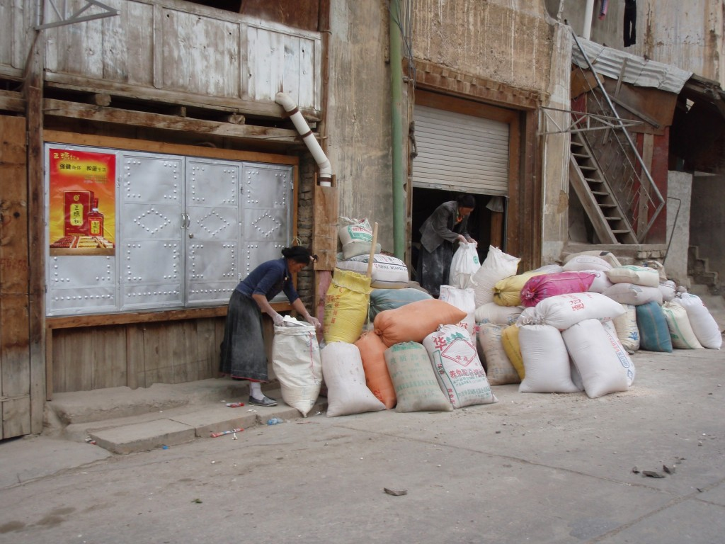 Woman filling sacks in SW China