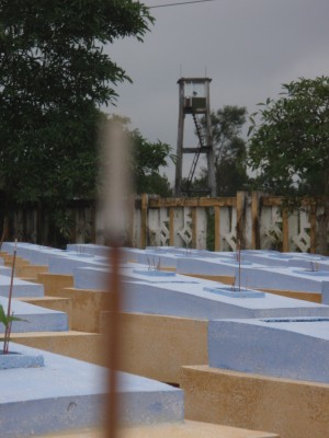 Incense burning on military graves in Vietnam