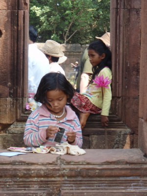 Vendor Girls at a Wat; no child care here, they work too.