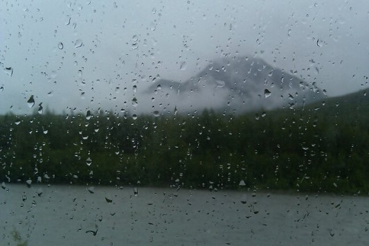 Rain on a window with Alaska view